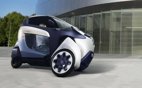 A single wheel in the rear provides propulsion. The front two wheels lean into turns like a motorcycle.