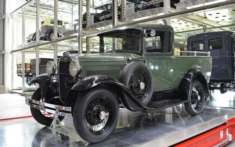 A 1931 Ford Model A Deluxe pickup truck moves through the rack system.