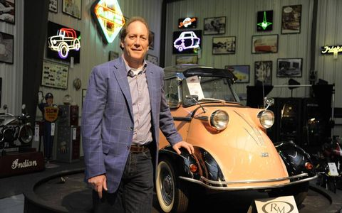 Bruce Weiner, candy magnate stands next to the $322,000 Messerschmitt