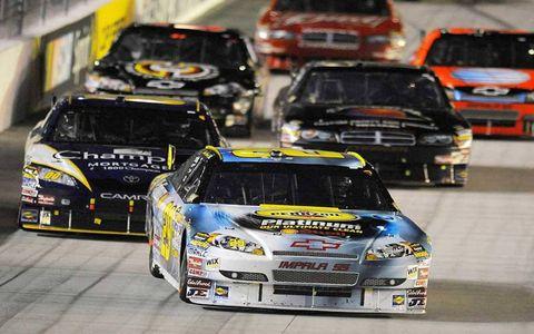 Automotive design, Vehicle, Land vehicle, Car, Motorsport, Hood, Sports car racing, Auto racing, Race car, Bumper,