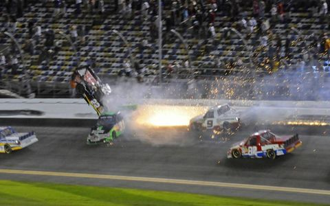 SCARY FLIGHT: Joey Coulter (No. 22) goes airborne on the final lap of the NASCAR Camping World Truck Series race on Feb. 24 at Daytona after contact with James Buescher (No. 31). Coulter was not injured.