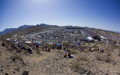 HIGH AND DRY: NASCAR fans take their perches among the desert terrain as Sprint Cup drivers hit the track at Phoenix International Raceway for the Subway Fresh Fit 500 on March 4.