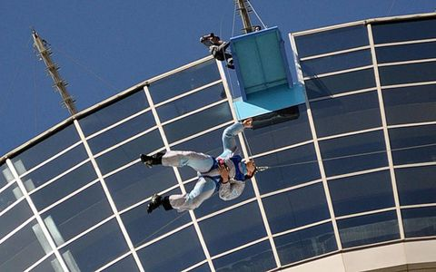 JUMPER WITH CABLE: NASCAR's Carl Edwards plunges off the Stratosphere Tower in Las Vegas, 180 stories above the ground.