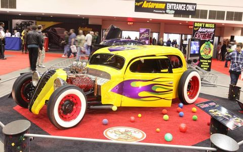 "Jim Curtis designed his entry, ""Looney Tunes"". It features a 3 inch channeled 1936 Ford Sedan steel body, the grill from a Hudson Teraplane, a 1950 flathead V8, a 12 bolt GMC truck rear axle, and an all stainless steel interior with four 1966 Mustang bucket seats."