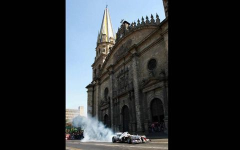 DOES HE HAVE A PRAYER? Sauber Formula One driver Sergio Pérez drives past the Guadalajara cathedral during an exhibition in his home country of Mexico in February.