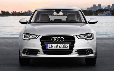 Motor vehicle, Mode of transport, Automotive design, Automotive mirror, Daytime, Automotive exterior, Vehicle, Vehicle registration plate, Transport, Headlamp,
