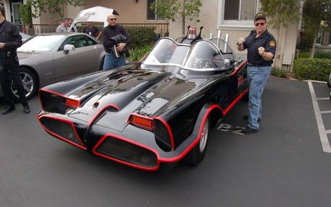 Nate Truman stands strong with his Batmobile.