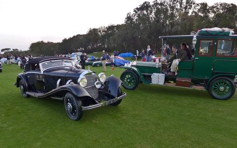 A rather upright Rolls-Royce putters past a sleek Mercedes-Benz.