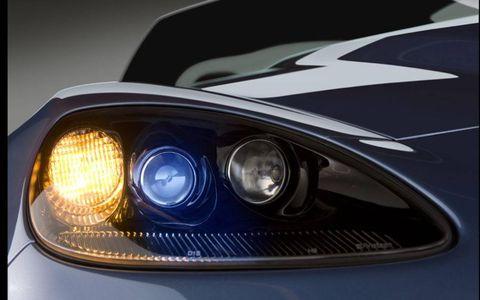 Automotive design, Automotive lighting, Headlamp, Automotive parking light, Hood, Grille, Car, Light, Personal luxury car, Automotive light bulb,