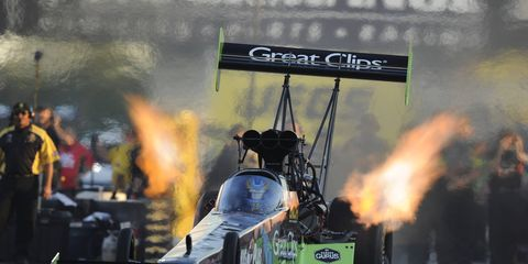 Clay Millican set the Lucas Oil Raceway elapsed-time track record with a 3.692 at 316.82 mph on Saturday night in Indianapolis.