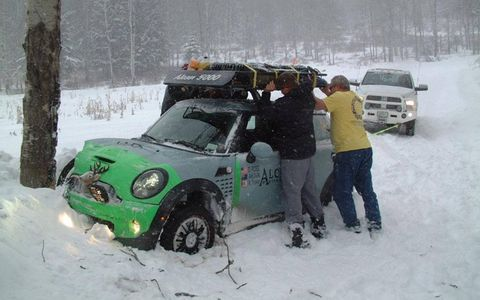 A Mini is extricated from the snowbank after an encounter with the local flora.
