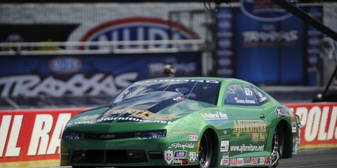 Aaron Strong drove his Chevrolet Camaro past Vincent Nobile at Indianapolis on Saturday night for the win.