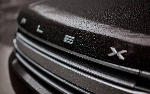 Automotive design, Grille, Automotive exterior, Bumper, Hood, Sport utility vehicle, Bumper part, Close-up, Luxury vehicle, Silver,
