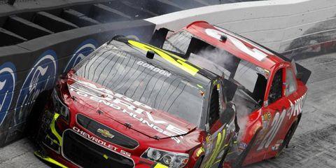 Jeff Gordon wrecks Matt Kenseth after blowing a tire.