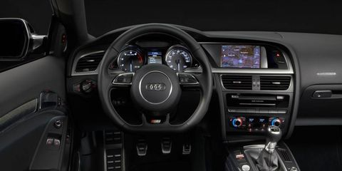 The interior of the 2013 Audi S5 coupe has had subtle changes from previous models, with the addition of a new gauge cluster and steering wheel.