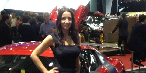 A booth babe draws attention to the ABT at the 2013 Geneva motor show.