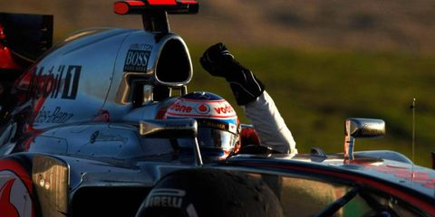 Jenson Button wins the Formula One opener at Melbourne on Sunday.