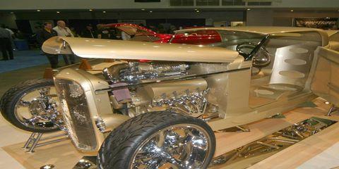 Motor vehicle, Automotive design, Automotive lighting, Auto part, Fender, Automotive tire, Spoke, Auto show, Classic, Exhibition,