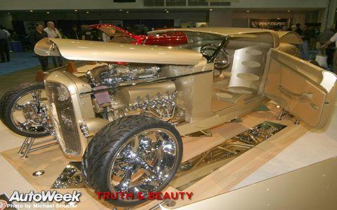 Motor vehicle, Automotive design, Automotive lighting, Fender, Auto show, Headlamp, Auto part, Classic, Exhibition, Antique car,