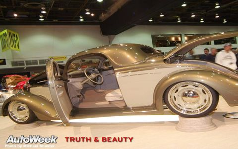 Tire, Motor vehicle, Wheel, Automotive design, Automotive tire, Vehicle, Automotive wheel system, Land vehicle, Vehicle door, Alloy wheel,