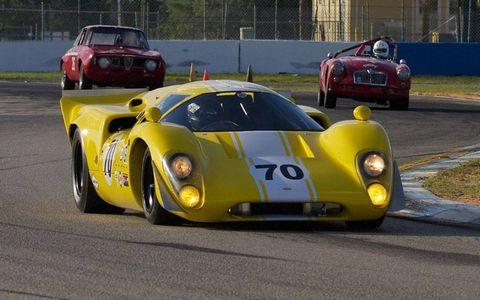 A 1969 Lola MkIIIB leads an Alfa GTV and an MGA.
