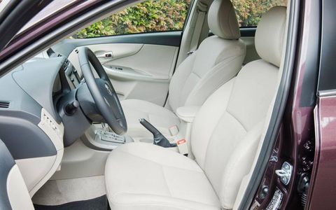 The Toyota Corolla LE interior adds a navigation, Toyota's Entune multimedia system, power and heated beige leather-trimmed seats and special-edition floor mats.