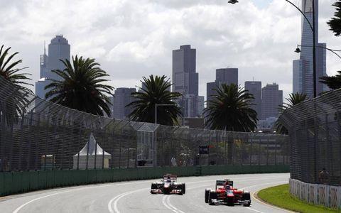 2012 Australian Grand Prix- Lewis Hamilton, McLaren MP4-27 Mercedes, passes Charles Pic, Marussia MR01 Cosworth.