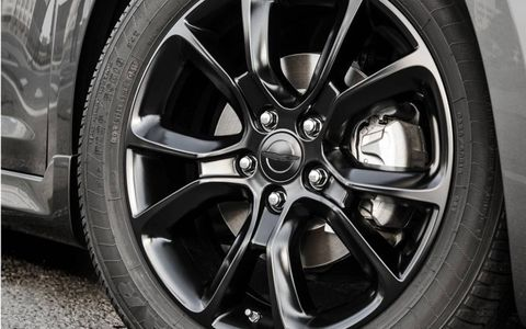 Eighteen-inch polished aluminum wheels with dark painted pockets accent the exterior of the 200 S Special Edition.