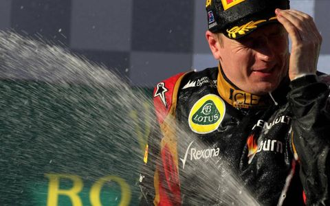 Kimi Raikkonen, Lotus F1, 1st position, sprays the Champagne.Photo by: LAT Photographic