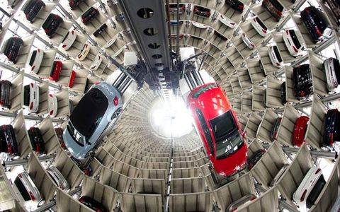 PUT IN STORAGE // A new Volkswagen Beetle Cabrio and Golf ride the elevators in the German automaker's storage facility in northern Germany. Photo by Sebastian Kahnert/AP Photo