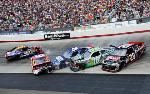 BUMP AND GRIND // Carl Edwards (99), Kasey Kahne (5), Marcos Ambrose (9), Kyle Busch (18), Kevin Harvick (29), tangle during the NASCAR Sprint Cup Series Food City 500 at Bristol Motor Speedway.Photo by John Harrelson/Getty Images for NASCAR