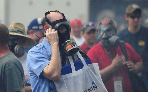 BREATHTAKING // Gas masks help cut the nitromethane fumes in the NHRA pits. These dedicated fans came prepared  for the event in Gainesville, Florida. Photo by Mark J. Rebilas