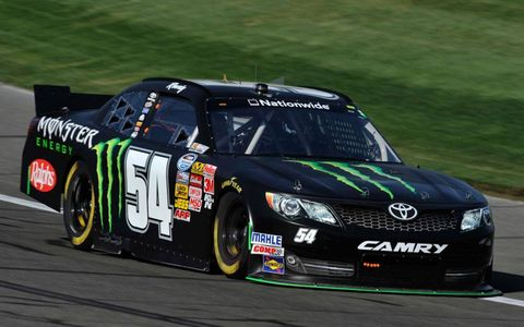 Kyle Busch held off Sam Hornish Jr. for the NASCAR Nationwide Series win at Fontana on Saturday.