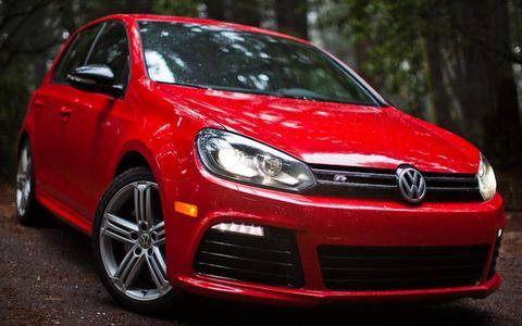 Tire, Automotive design, Vehicle, Land vehicle, Alloy wheel, Car, Automotive lighting, Red, Rim, Automotive wheel system,