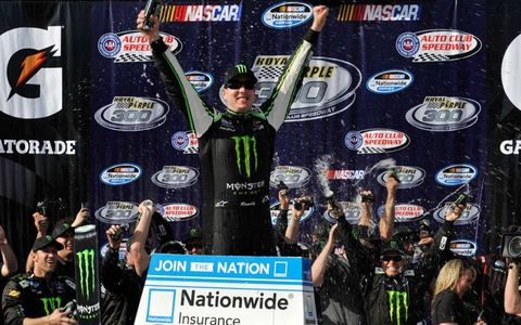 Kyle Busch celebrates his third NASCAR Nationwide Series win of the season.