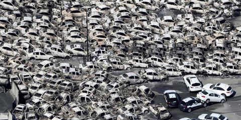 SEA OF DISCONTENT // Nissan and Infiniti vehicles were washed away by the tsunami at Hitachinaka, Japan, on March 11. The 9.0-magnitude earthquake north of Tokyo triggered fires and a tsunami. Photo by: The Yomiuri Shimbun/AP Images