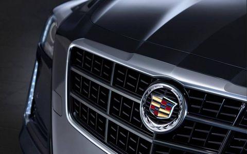 Motor vehicle, Automotive design, Daytime, Grille, White, Automotive lighting, Car, Headlamp, Light, Logo,