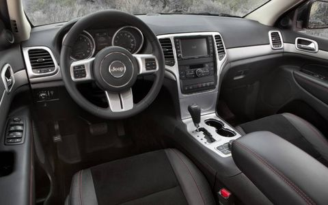 The interior of the 2013 Jeep Grand Cherokee Trailhawk has luxury SUV amenities, while maintaining a rough off-road-vehicle appearance.