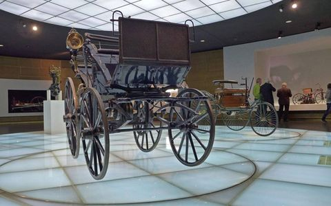 Daimler and Benz's early creations are displayed side-by-side.