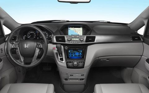 Inside the 2014 Odyssey, push-button start and a restyled center stack with added capabilities bring the interior up to date.