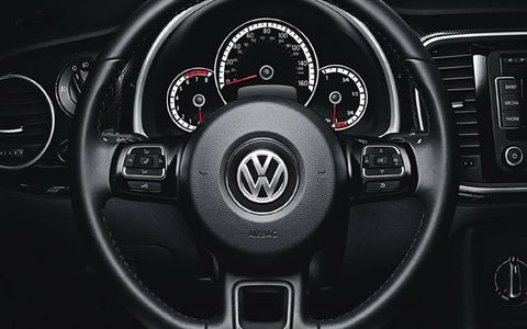 Our test 2013 Volkswagen Beetle Turbo convertible included the sunroof and sound trim level that included a leather-wrapped steering wheel, a Fender premium sound system and much more.