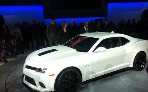 The 2014 Camaro Z/28 uses the LS7 7.0-liter V8 from the Corvette Z06, rated at 500 hp and 470 lb-ft of torque.