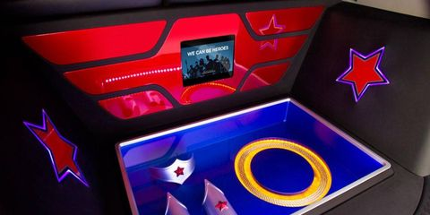 The cargo area has a transparent panel to display Wonder Woman's tiara, bracelets and glowing Lasso of Truth.