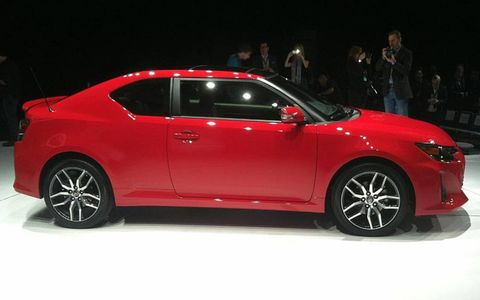 A side view of the 2014 Scion tC on the New York auto show stand.