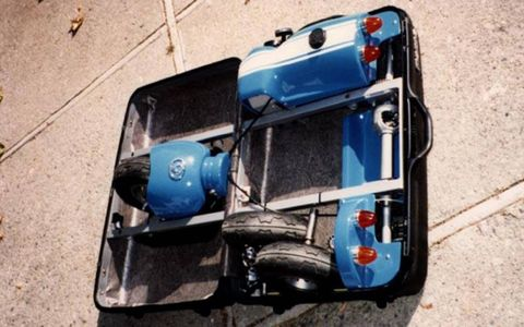 The Mazda Suitcase car with case open and equipment stowed.
