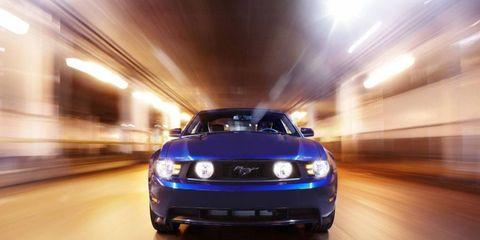 Automotive design, Yellow, Automotive lighting, Hood, Headlamp, Infrastructure, Grille, Automotive exterior, Car, Amber,