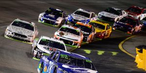 Martin Truex leads a pack of cars during the Monster Energy NASCAR Cup Series Federated Auto Parts 400 on Saturday night at Richmond Raceway.