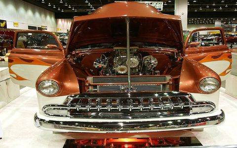 Francis and Karen Schaubel's '52 Chevy Fleetline Fastback has chrome accents and a painted roll cage.