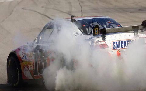 Kyle Busch celebrates his Atlanta win with tire smoke.