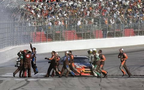 Kyle Busch's crew joins the party at the start/finish line in Atlanta.